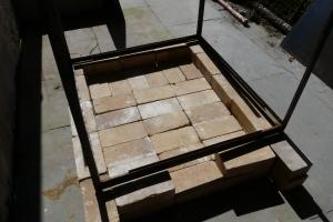 Metal frame on base